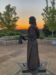 Jesus sculpture at sunset