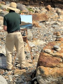 Painter on shoreline